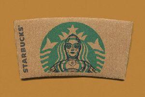 unbekannter K�nstler bemalt Starbucksemblem