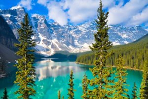 Travel Canada by train cross through lakes forests mountains