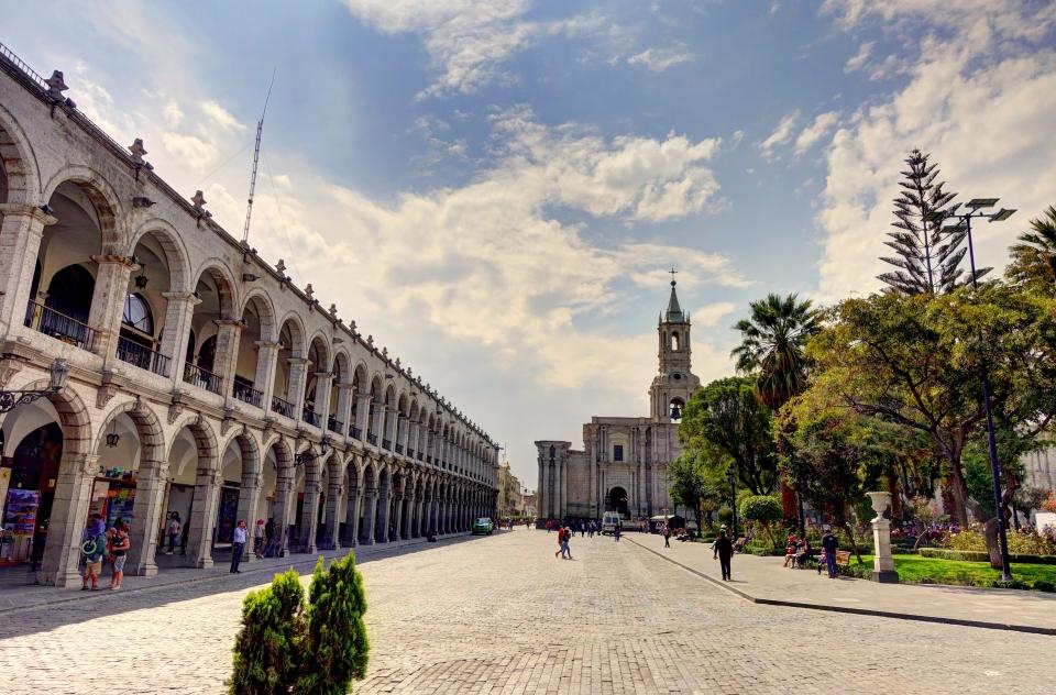 Watch daily life at Plaza de Armas