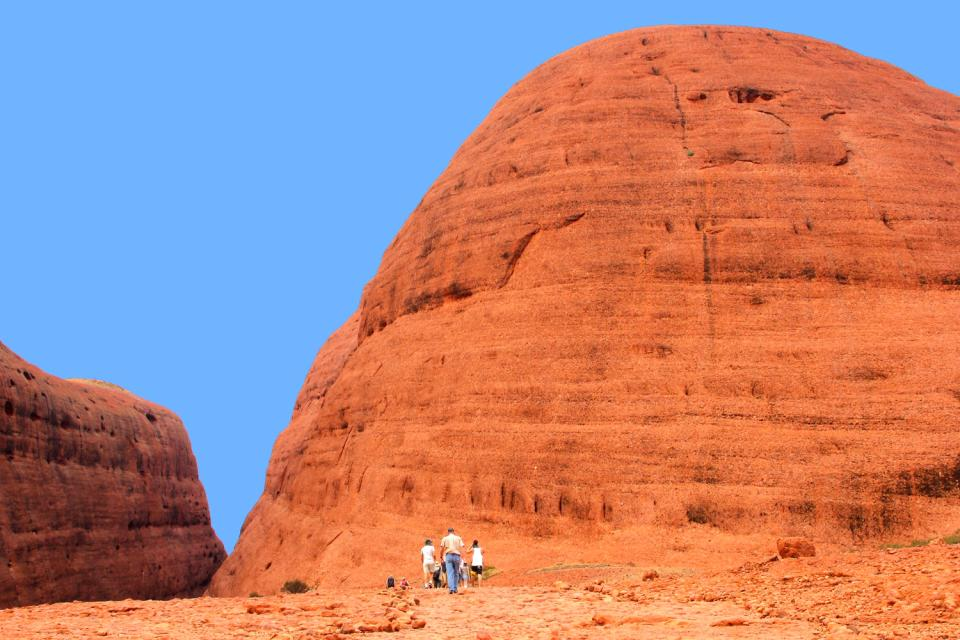 The Red Centre, Ayers Rock, the Northern territory , Hikers climbing in the Red Center, Australia , Australia