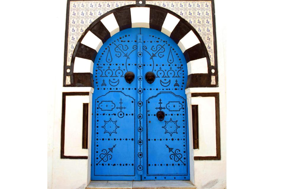 Studded wood doors , A studded wooden door , Tunisia