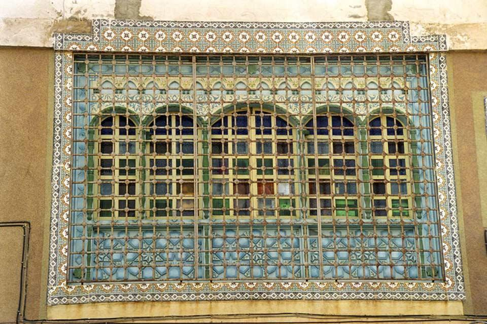 Cast iron grills , A wrought iron grate , Tunisia