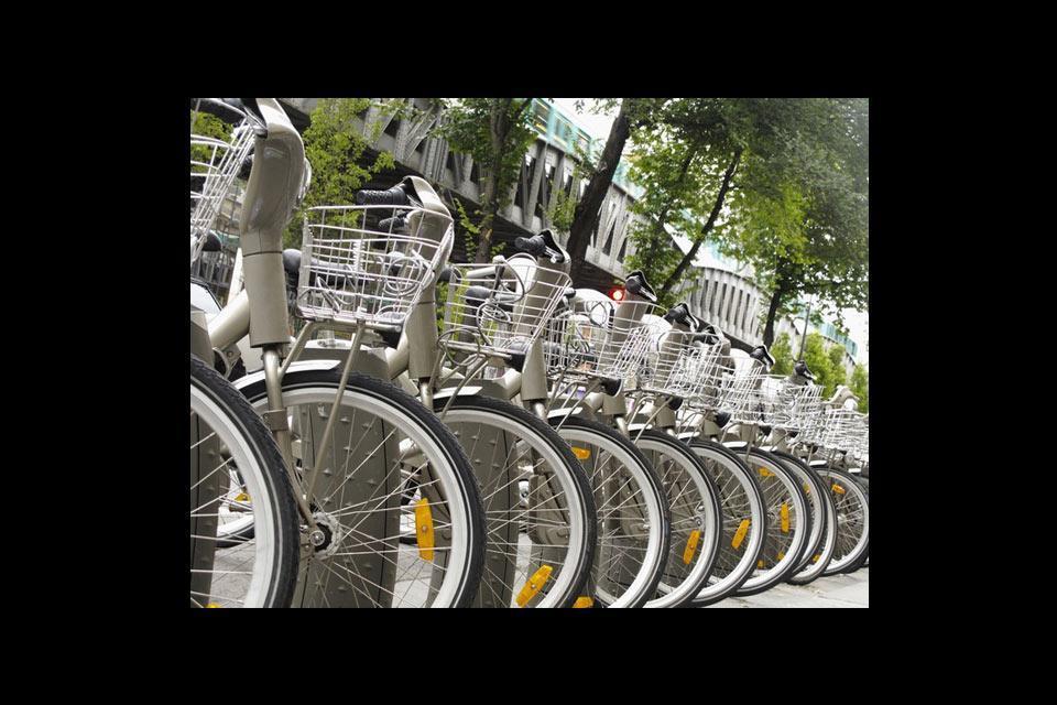 Ile-de-France on foot and by bike , A Parisian Vélib' station , France