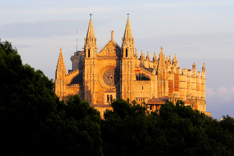 Palma Cathedral , The cathedral lit up by the setting sun , Spain