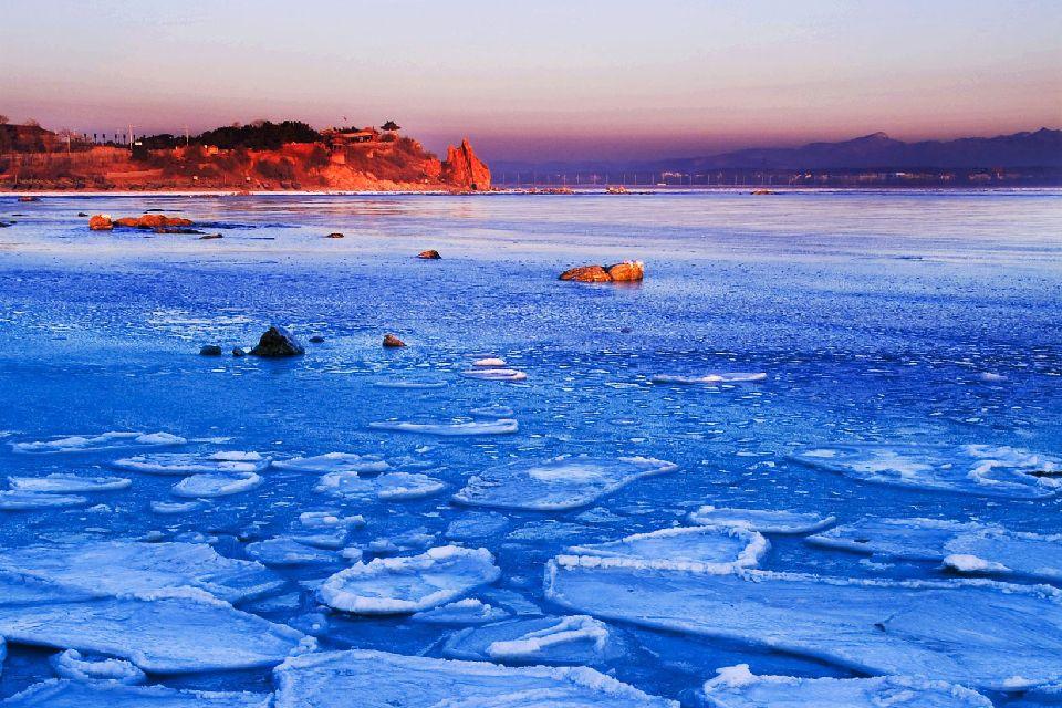 La plage de Beidaihe , Soleil couchant sur la plage de Beidaihe , Chine