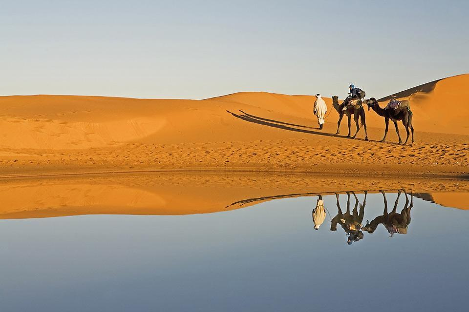 The Sahara , An expanse of water in the Sahara , Morocco