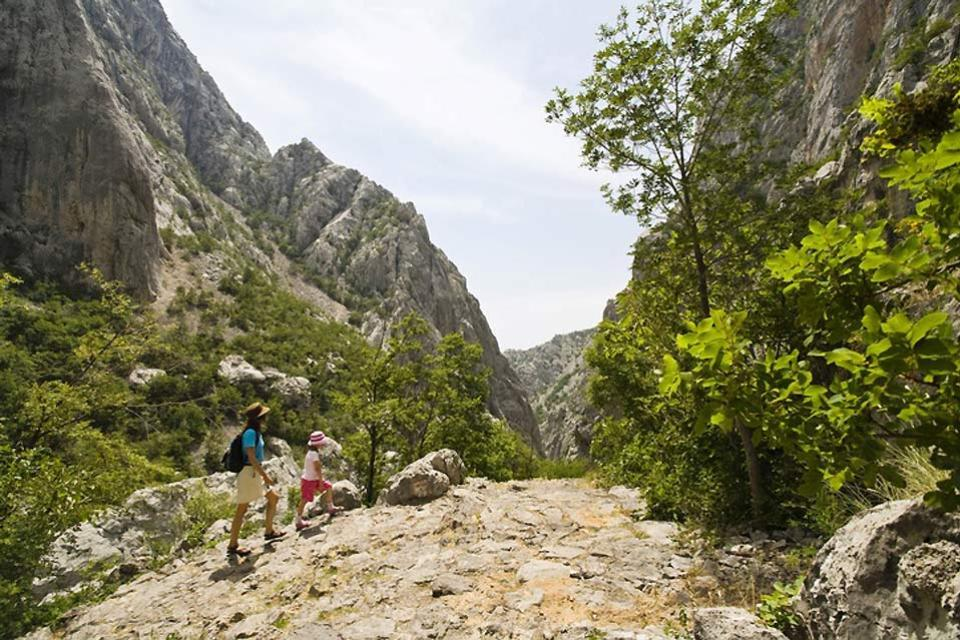 Paklenica National Park , Hikers in the Velika Paklenica Canyon , Croatia