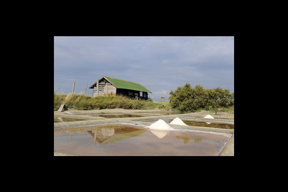 A couple of miles north of the town, the Saltworks are a protected natural zone where you can see the workers harvesting the salt.