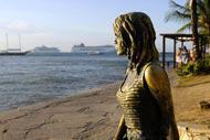Tourists flock to the Orla Bardot to be photographed with the bronze statue of Brigitte Bardot.