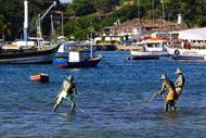 The three fishermen casting a net just opposite the Orla Bardot may not be real but they certainly look pretty life-like, especially at high tide!