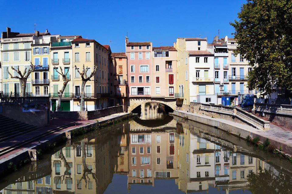 Located in the east of the Aude administrative region, Narbonne (named after the old Roman colony of Narbo-Martius) looks longingly towards the Mediterranean.  It is some 9 mi from the coast and the seaside resort of Narbonne-Plage. Further west and inland is Carcassonne, followed closely by the Pyrenees and then Spain. One of Narbonne's strengths is the central status art has long enjoyed in town ...