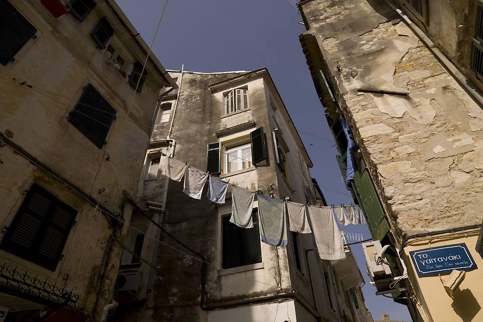 It is perfectly normal in Corfu to see washing hanging out to dry between two buildings.