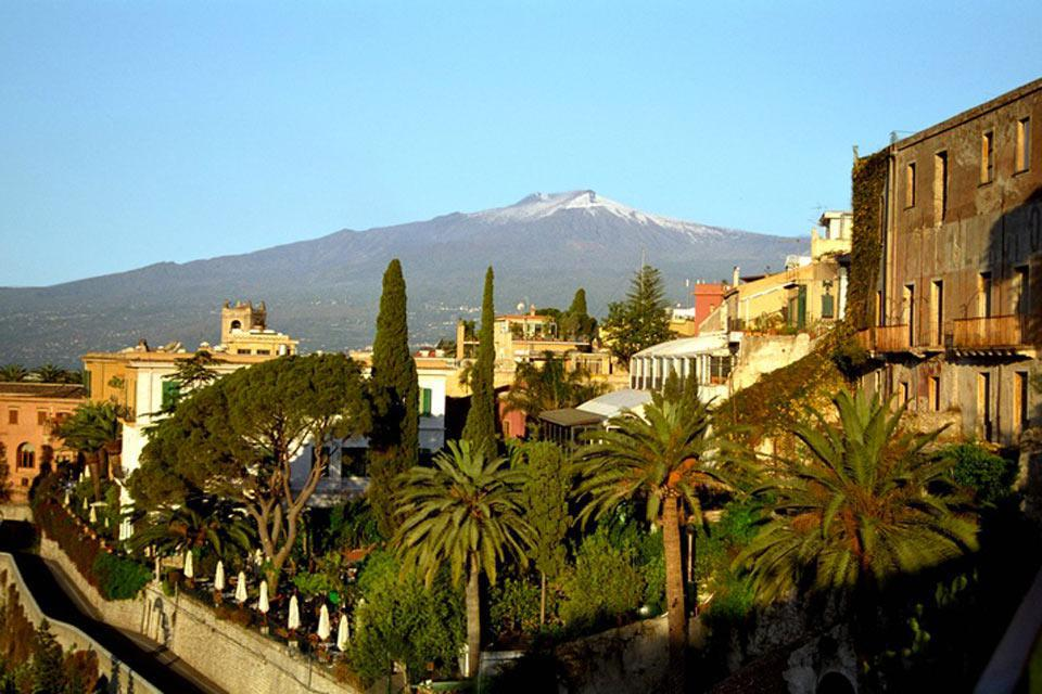 Catania is located on the eastern coast of the island, against the backdrop of Mount Etna