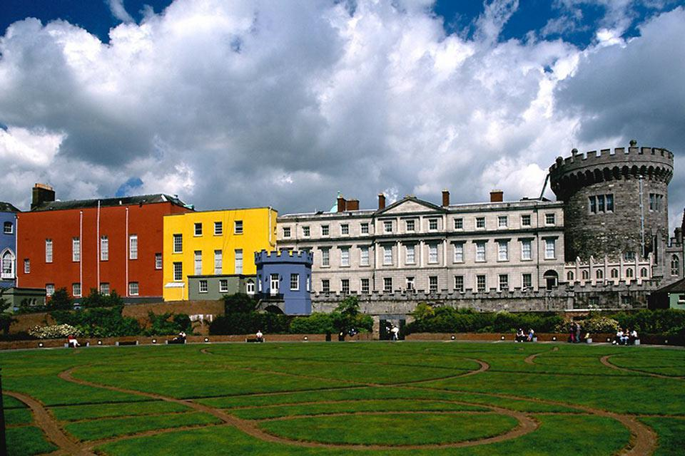 Dublin Castle, bordered with recent colourful constructions, towers over a beautiful and well-maintained garden