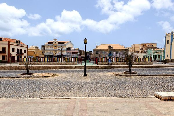 At first sight, Boa Vista's administrative centre is not particularly alluring. Dusty roads lined with small buildings lead to a rectangular square where most of the island's activities take place. Yet, the little streets between the square and the port are not lacking in charm. At one bend in the road you come across fishing boats resting on the beach, where a handful of women are selling fish while ...