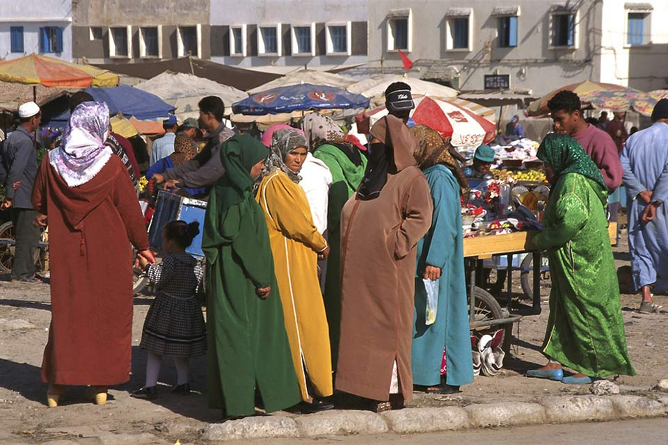 Local women gather at the market to chat and buy spices, fruit and vegetables.
