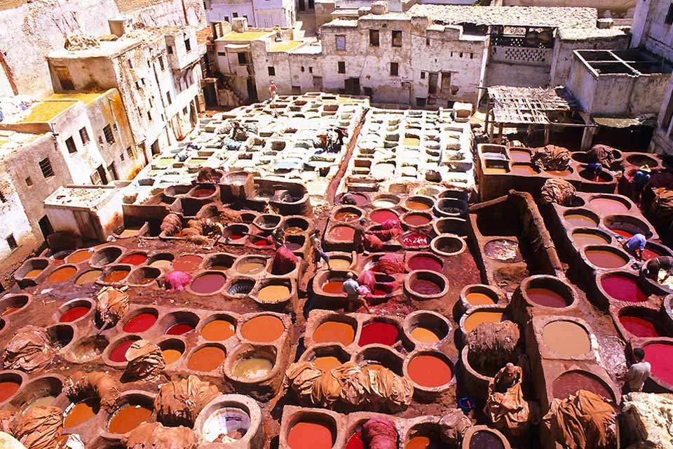 The dyers' vats are used to dye the leather goods sold in the souks. It is a very typical aspect of the Moroccan culture.