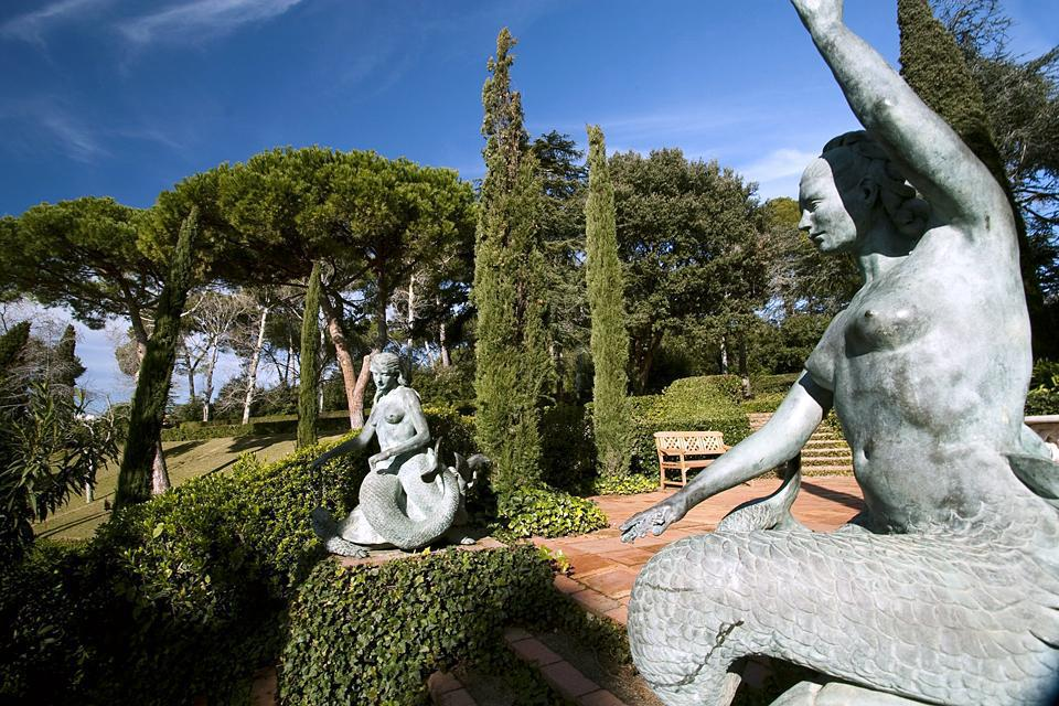 These famous gardens on a slope stretch out towards the edge of a cliff. They are especially known for the long green flight of stairs lined with bronze mermaids created by sculptress Maria Llimona.