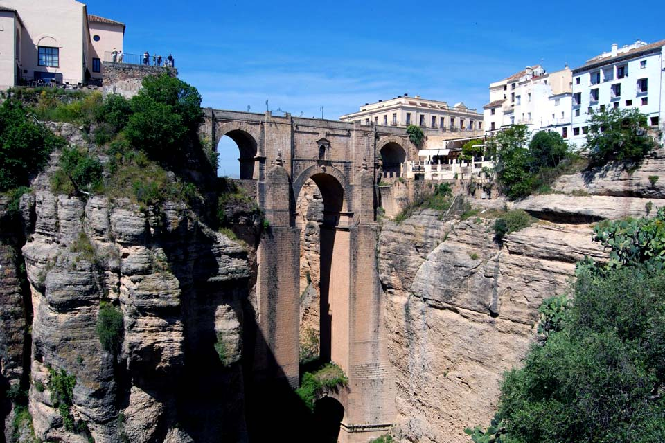 Built on a rocky cliff, Ronda is one of Spain's most ancient towns. Separated in two by a deep gorge, it is proud of its Puente Nuevo, a bridge built in the 18th century, suspended at a height of 328 ft. Sites of interest include the Mondragon Palace, a remarkable Arab style residence that includes a museum and the Plaza de Toros, the first Spanish arena, inaugurated in 1785. It is actually in Ronda ...