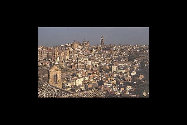Toledo means hot sun and slanting alleys, the harsh angularity of El Greco, and the mystique of the Jewish quarter