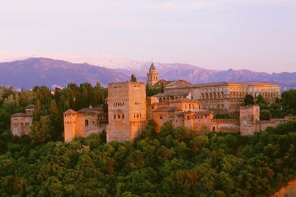 A panoramic view of the Alhambra with the Sierra Nevada in the background.