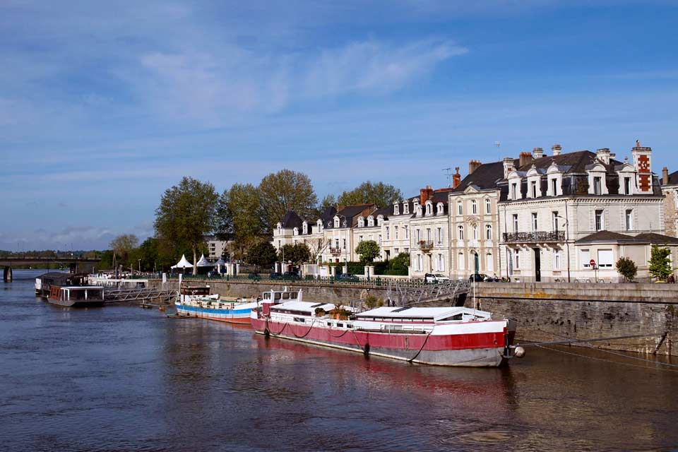Situated at the entrance of the Loire Valley, Juliomagus (magus: Gaulish market) is the capital of Anjou. Towering above the city, the fortress castle is a token of its powerful past (it was the capital of a kingdom stretching from England to Gascony in the time of the House of Plantagenêt) and is home to one of the world's most famous traditional tapestry manufacturers: the Tenture de l'Apocalypse. ...