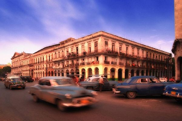Colonial buildings and ancient cars line the streets of Havana