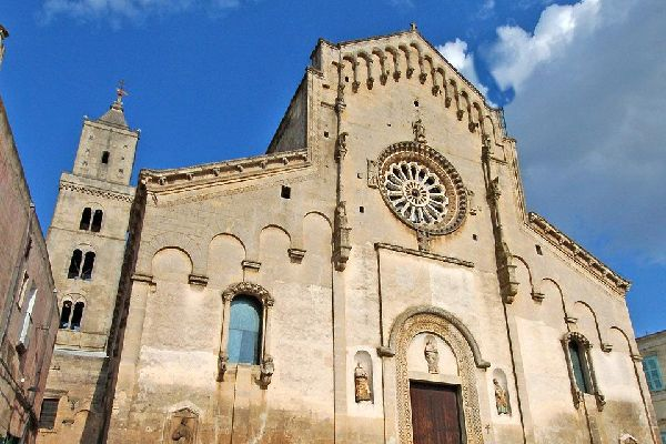 """Built on the highest spur of the """"Civita"""" which separates the two """"Sassi"""", the 18th century Matera Cathedral was built in the Roman style typical of the Apulia region."""