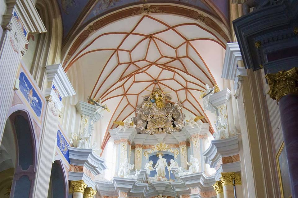 The luminous church of Vytautas displays a typical star-shaped vault.