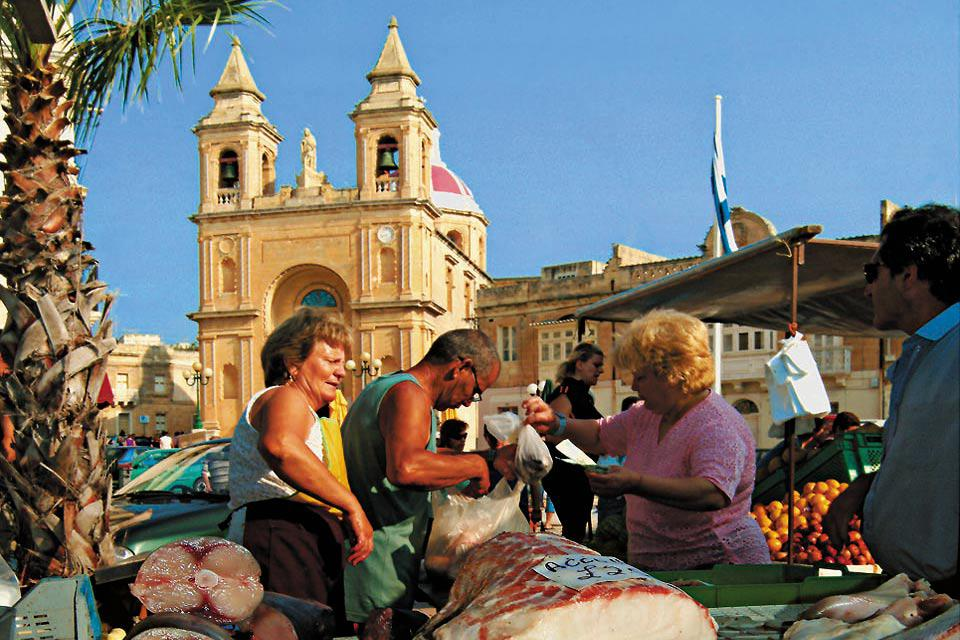 Marsaxlokk is famous for its vibrant markets where you can find the catch of the day.
