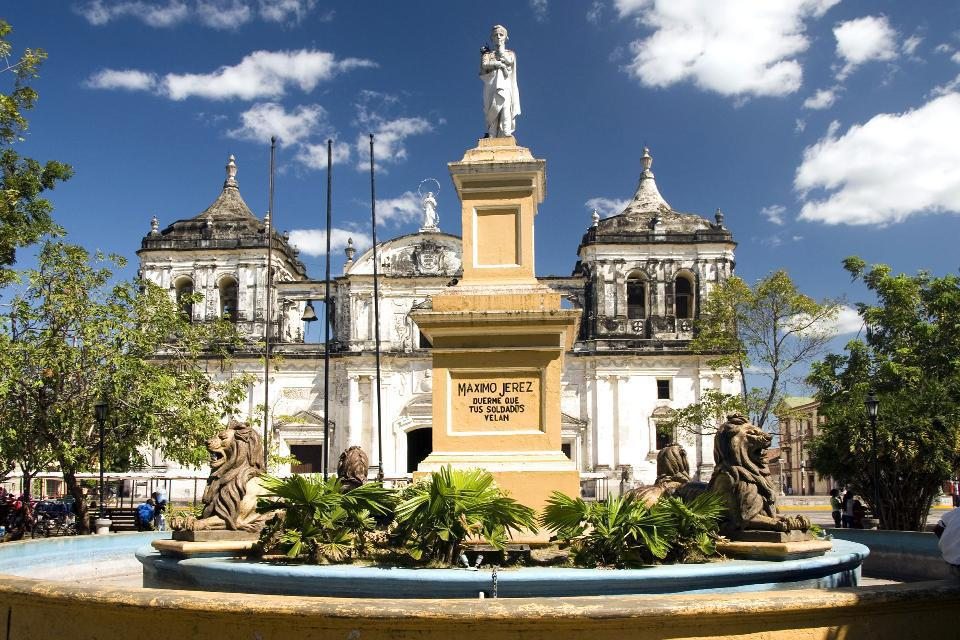 A neoclassical-style building built in 1706, the San Pedro Cathedral stands on a small, colonial-style square.