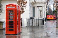 Telephone booths are always popular with the tourists