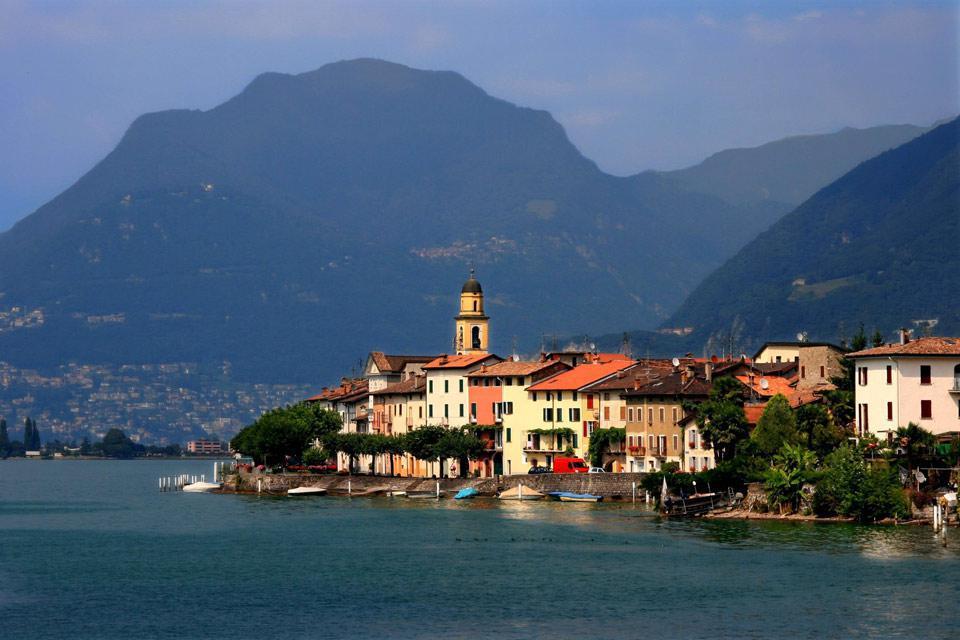 Die Stadt Lugano mit ihren farbenprächtigen Häusern ist von einem typisch italienischen Flair durchdrungen. Die offizielle Landessprache dieses Kantons ist Italienisch!