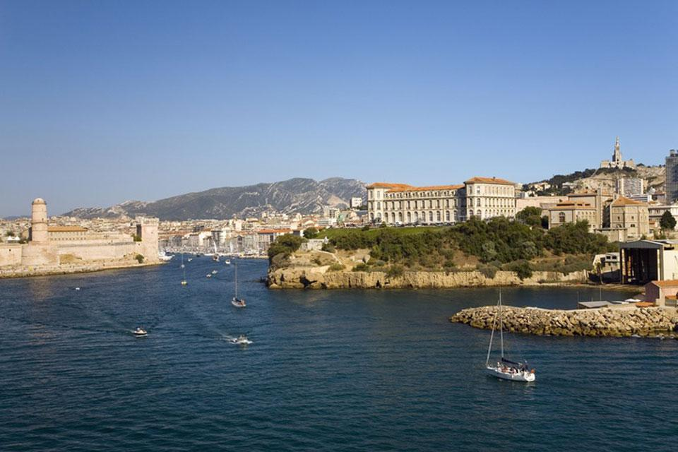 As you enter Marseille from the sea, you will be greeted by Pharo Palace and Fort Saint-Jean.