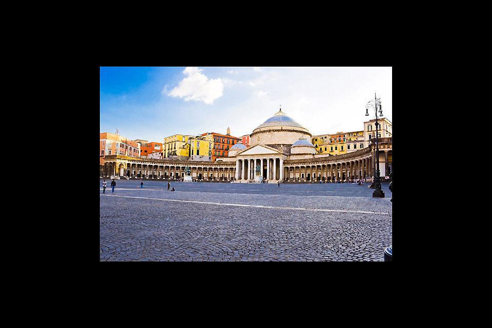 The monumental Plebiscito Square at the heart of the city is sheltered by the San Francesco di Paola church and the Royal Palace.