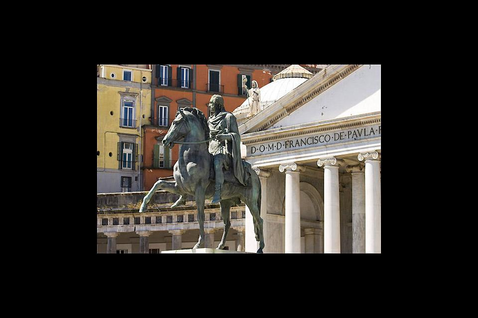 The equestrian statue in the historic district of Naples is dedicated to Charles III of Spain.