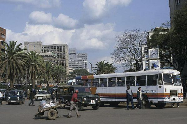 Locals go about their daily business in the bustling city of Nairobi.