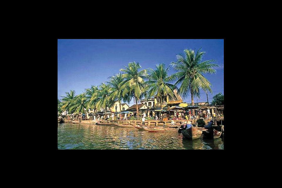 Criscrossed by charming narrow streets lined with red-brick houses, Hoi An also has a beach.
