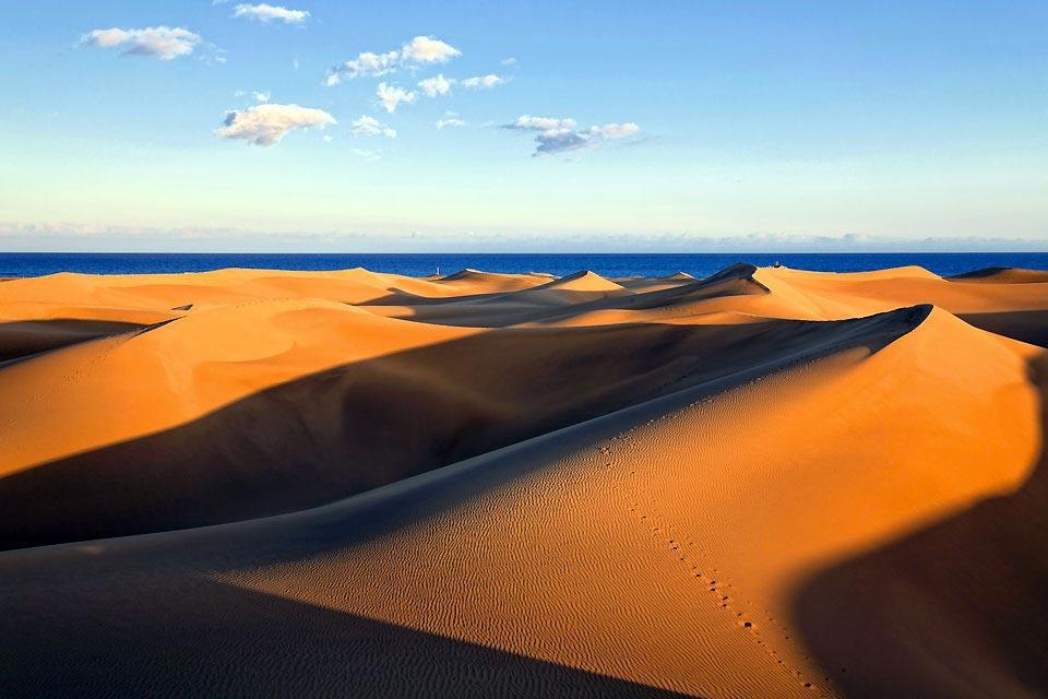The several miles of the Maspalomas sand dunes stretch out west of Playa del Inglès, the island's main seaside resort, in a 'Lawrence of Arabia'-like setting. These shifting hills line huge beaches where visitors can take part in numerous seaside activities....