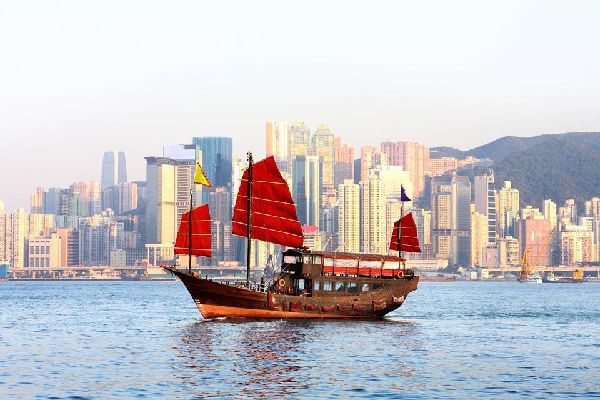 This traditional Chinese boat sails the waters of the Kowloon Peninsula.