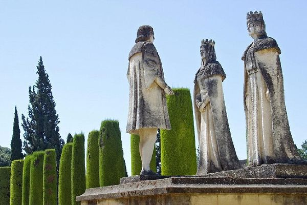 A sculpture of the Catholic Monarchs and Christopher Columbus in the gardens of the Alcázar in Córdoba.