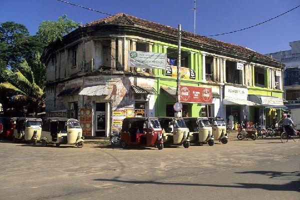 Streetscape with treewheeler taxis in Negombo, Sri Lanka.