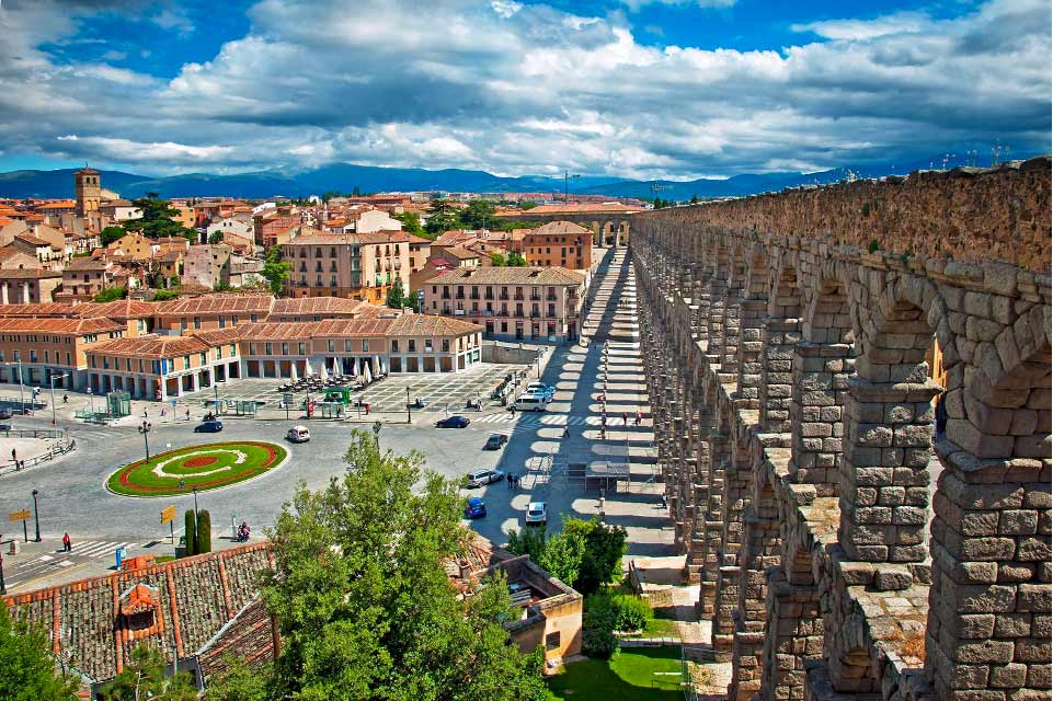 The city of Segovia is built on top of a rocky promontory separating two rivers. The Alcazar overlooks the whole city. On the opposite side, a Roman aqueduct, built at the end of the First Century AD., spreads over more than 800 m. Some of the 128 arches can be as high as 29 m. Its important Cathedral, its remarkable Romanesque churches, and its various convents and monasteries are also part of its ...