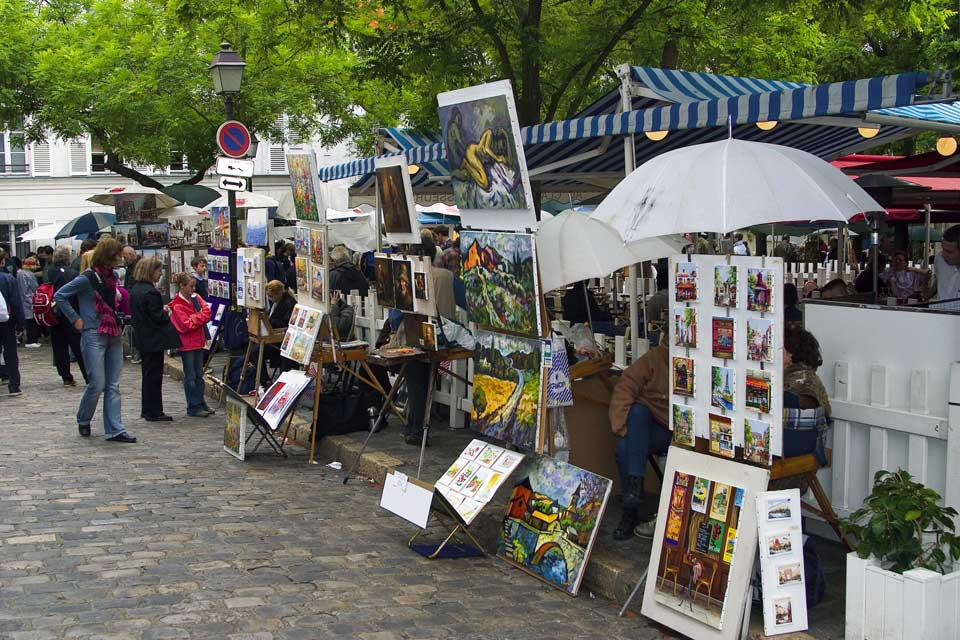 Place du Tertre is the home of painters and caricaturists who are always ready to draw your portrait.