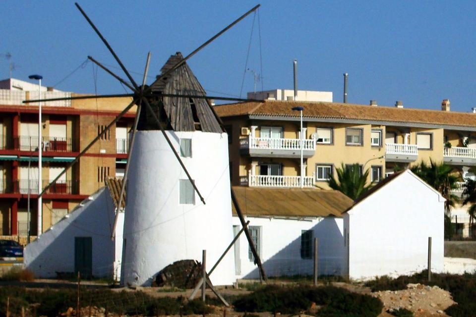 Murcia is a vast region encompassing dunes and beaches but also windmills at the salt flats.