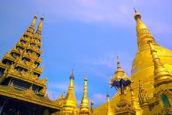 Rising 112 metres, its summit is decorated with a golden ball inlaid with over 2,500 precious stones.