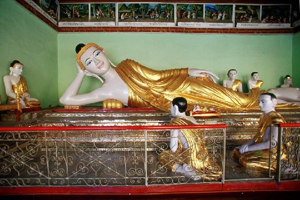 The golden pagoda of Shwedagon is home to many recumbent Buddhas.