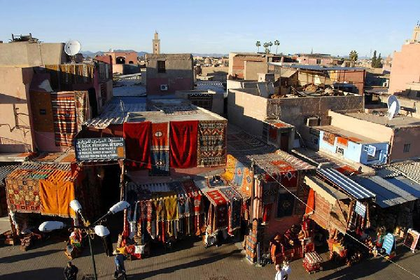 What would Marrakesh be without its lively souqs bursting with the colours of precious fabrics?