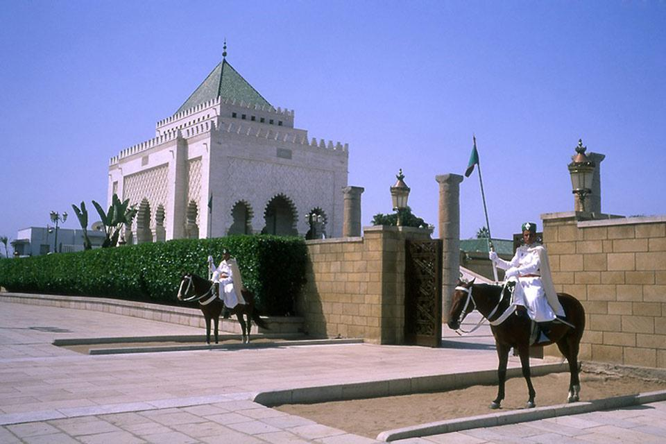 The entrance to the Hassan Tower is watched over by two guards on horseback. The tower is 45 metres high.