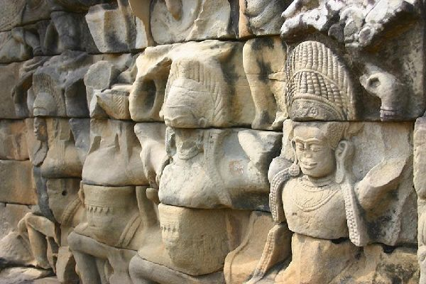 The statues that adorn the temples of Angkor are perplexingly beautiful.